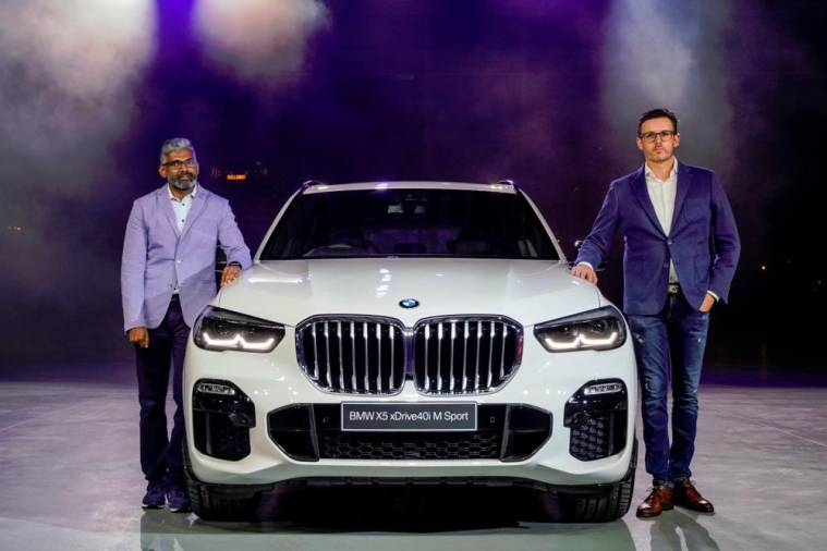Hoelzl (right) and BMW Group Malaysia head of corporate communications Sashi Ambi with the fourth-generation BMW X5.