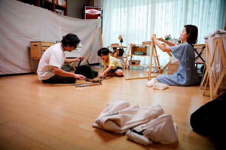 Lee Seung-yoon, his wife Che Min-hee and their son Lee Ji-sung set up camping gear as they prepare for a staycation at their home amid the coronavirus disease (COVID-19) pandemic, in Seoul, South Korea, August 22, 2020. Picture taken on August 22, 2020. REUTERS/Kim Hong-Ji