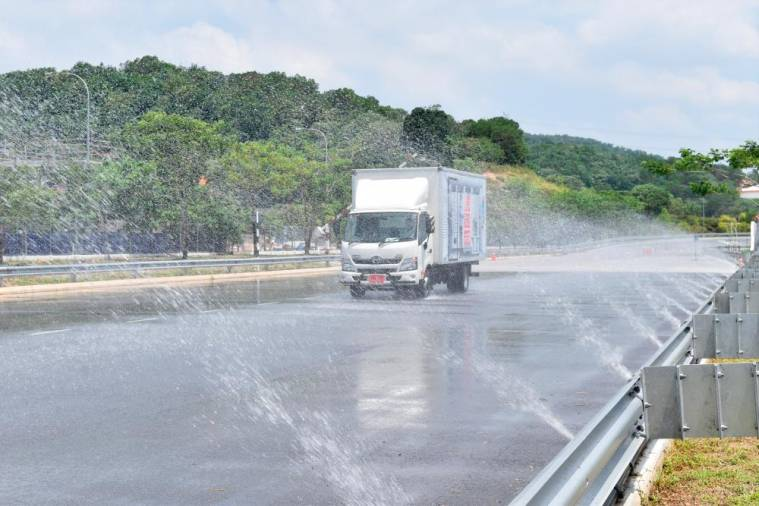 A stretch at the HTSCC is purposely sprinkled with water to simulate wet road condition, and also to test Hino lorries' anti-lock braking system and stability, and also the driver's ability.