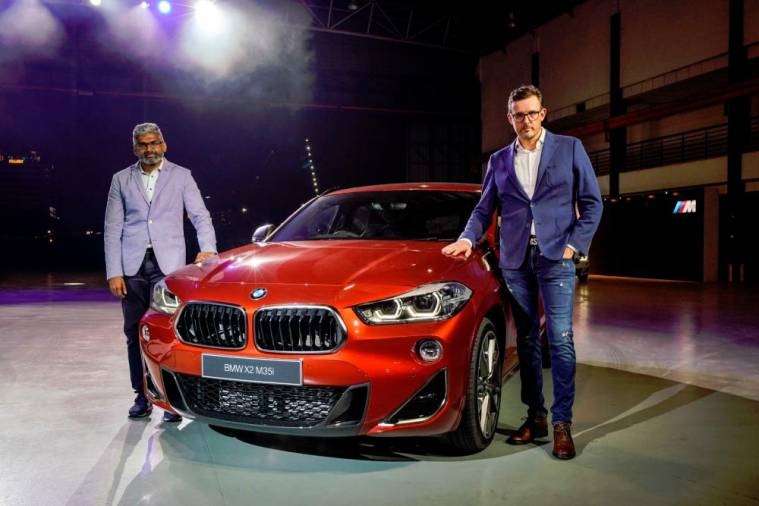 Hoelzl (right) and BMW Group Malaysia head of corporate communications Sashi Ambi with the BMW X2 M35i.