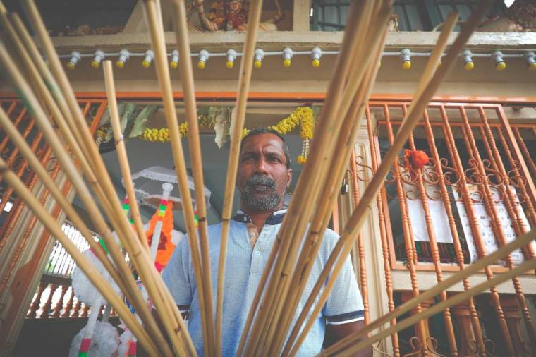 Beside plain woods, he also used steel, paper and rattan to design kavadi.