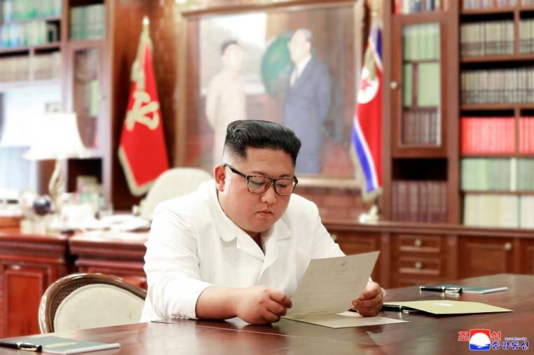 (FILES) This undated file picture released from North Korea's official Korean Central News Agency (KCNA)on June 23, 2019 shows North Korean leader Kim Jong Un reading a personal letter from US President Donald Trump at an unknown location. AFP PHOTO/KCNA VIA KNS