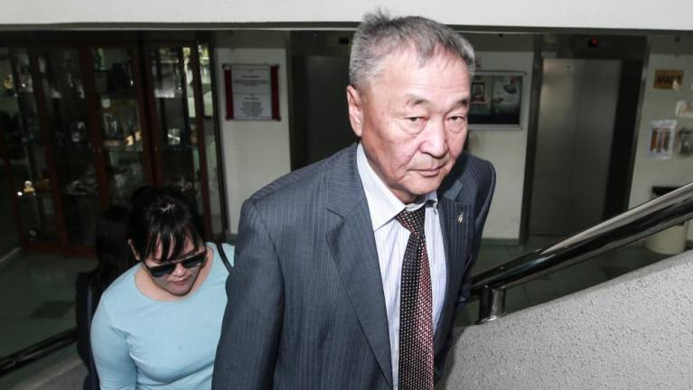 I have seen the photo of my daughter with two men: Altantuya's father
