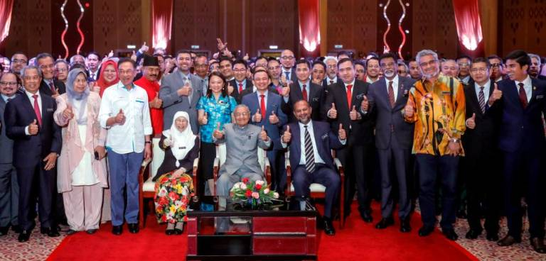 Prime Minister Tun Dr Mahathir Mohamad joins Cabinet and other Pakatan Harapan leaders in a group photograph to make the first anniversary of New Malaysia. SUNpix by Ashraf Shamsul/THESUN