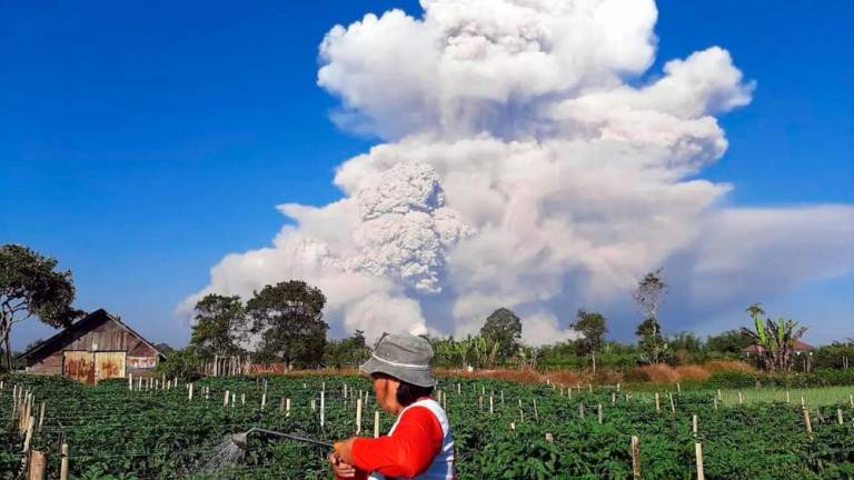Indonesia's erupting Sinabung volcano belches column of ash