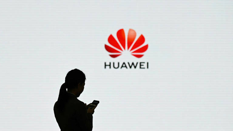 Trump hints at softer stance on China's Huawei