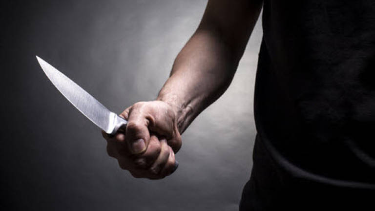Man stabs wife to death in fit of jealousy