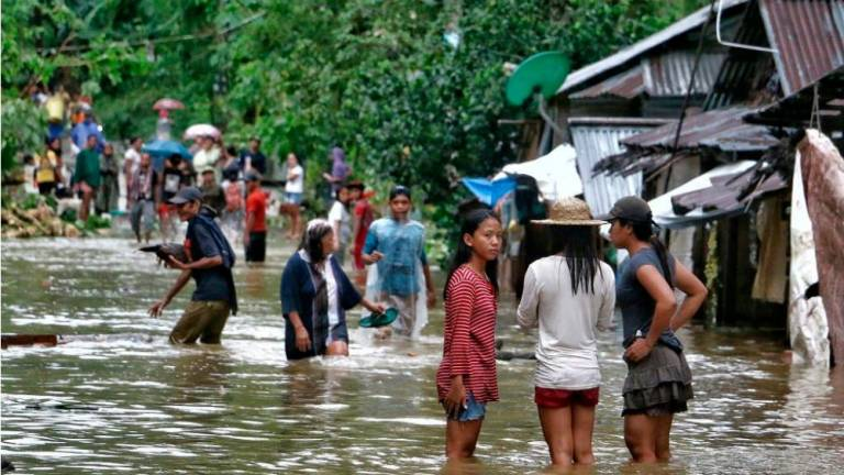 Four dead as storm sweeps through central Philippines