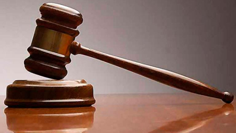 Engineer fined RM4,000 for posting half-naked photo of ex