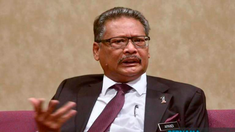 Apandi breaks down while testifying in suit against Kit Siang