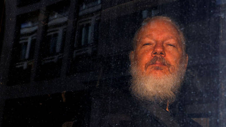 WikiLeaks founder Assange remanded in jail after brief UK court hearing