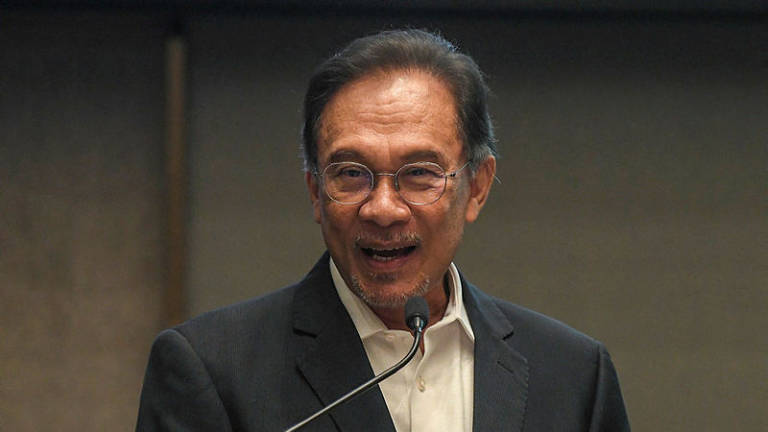 Anwar plays down conflict, says all is fine in PKR