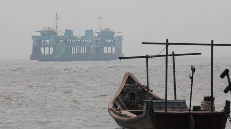Local fishermen lost at sea due to haze rescued by Indonesians