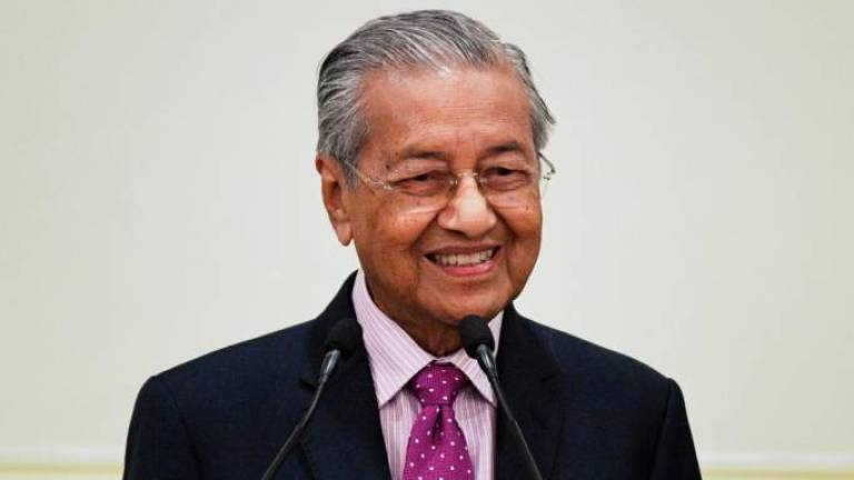 Good job letting professionals handle Covid-19: Tun M