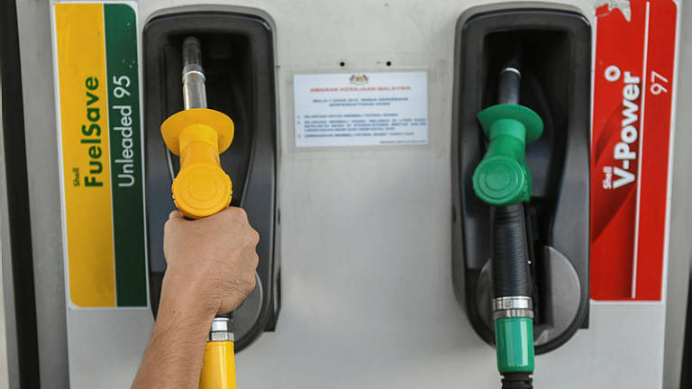 Fuel prices: RON97 down 2 sen, RON95, diesel unchanged
