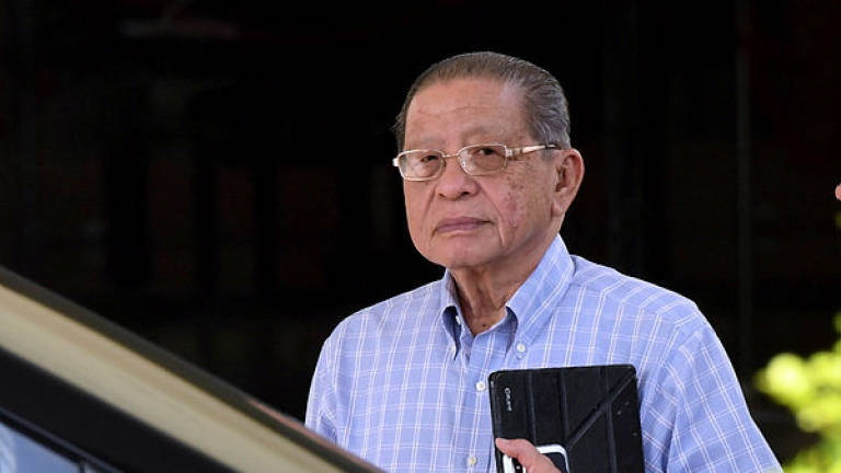 Kit Siang, Hanif Omar may settle lawsuit out of court