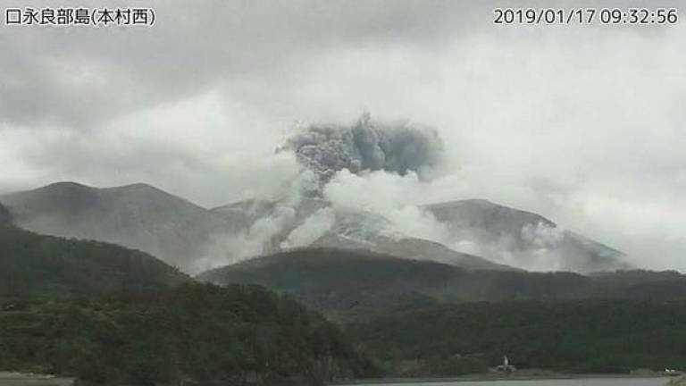 a video grab from the japan meteorological agencys live camera image shows an eruption of kuchinoerabu