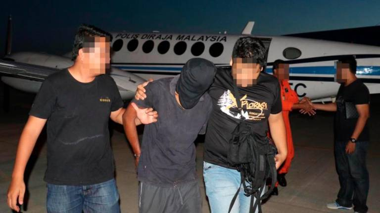 Four nabbed over terror attack plans in Malaysia (Updated)