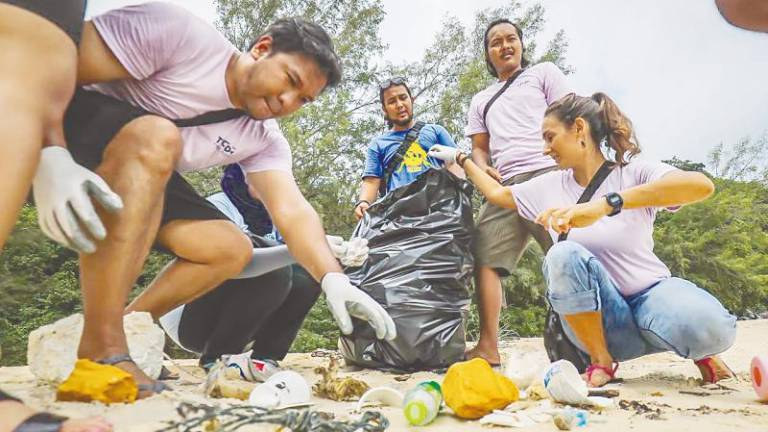 NGOs in Pulau Tioman recycle waste into construction material