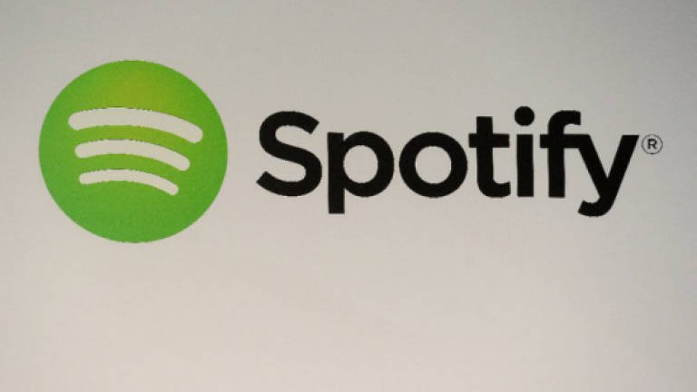Spotify agrees to fund to settle copyright suits
