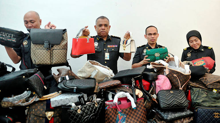 Four outlets selling fake branded items raided in JB