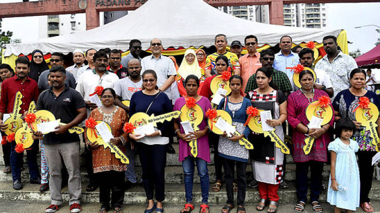 24 squatter families celebrate Deepavali in new homes