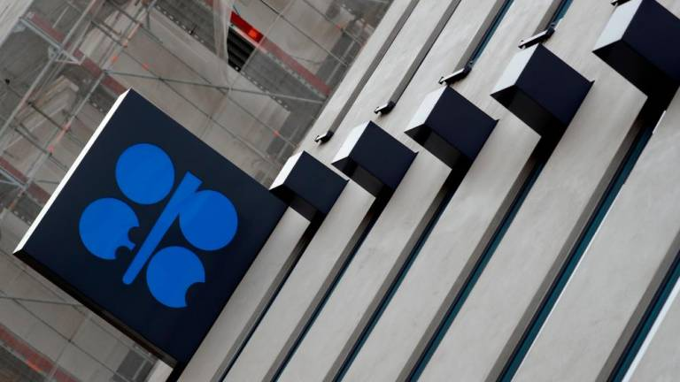 OPEC squeezes oil output to 4-year low, Russia compliance low