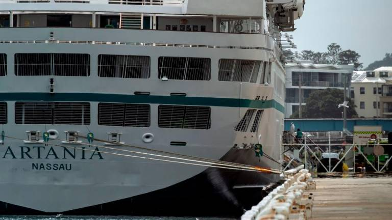 Virus cases spike after Australia cruise ship stand-off ends