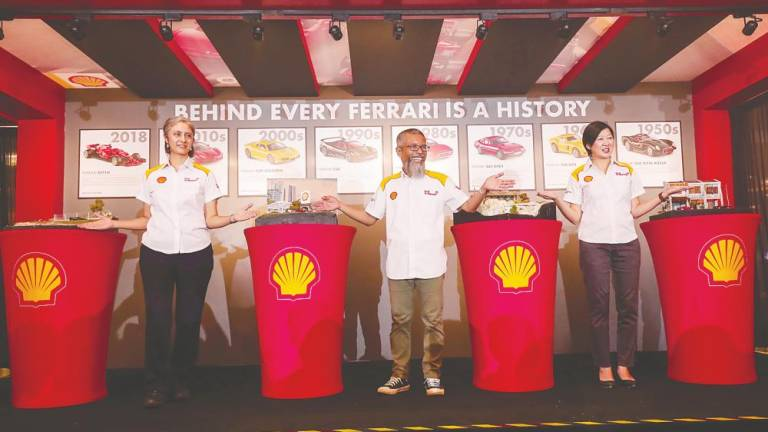 (From left) Zharin, Shairan and Shell Head of Retail Marketing Chung Ai Kee introduce Shell ShowVroom at the launch. - SUNPIX/Ashraf Shamsul