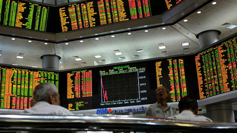 Bursa Malaysia turn lower on profit-taking