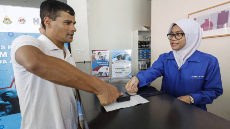 Biometric system for foreign workers' medical tests from Oct (Updated)