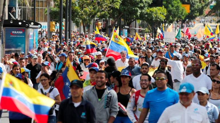 Venezuela opposition takes to streets over blocked aid