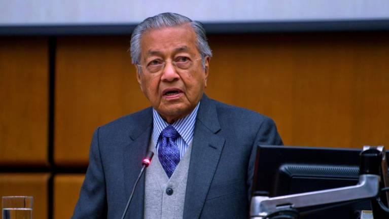 Govt to discuss with EC on restriction involving cabinet ministers: Mahathir