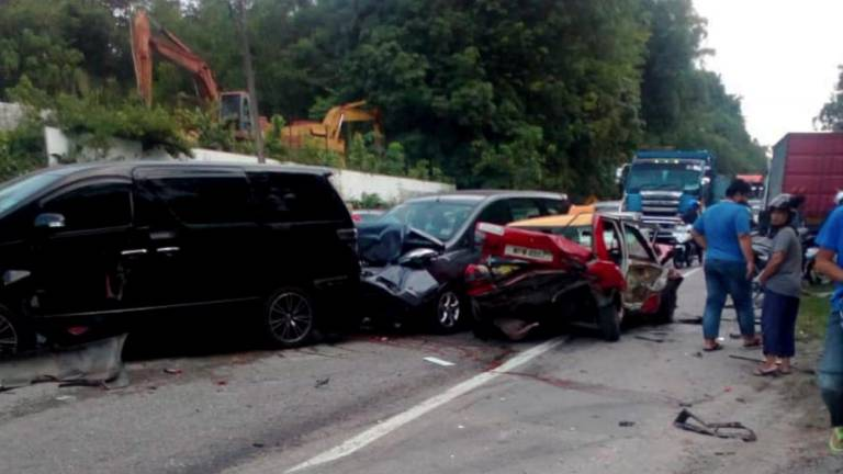 Four hurt in 13-vehicle collision in Nilai