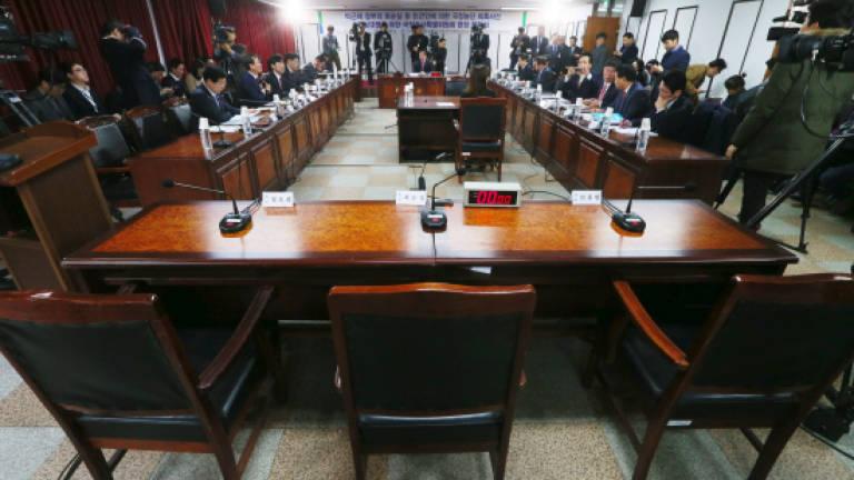 Lawmakers quiz S  Korea's elusive 'Rasputin'