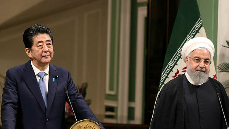 Japan PM to meet Iran's supreme leader seeking to ease US tensions