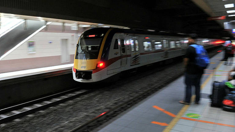 Two men die after being hit by KTM Komuter train