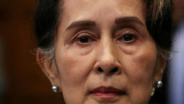 Suu Kyi slammed for 'silence' over Myanmar genocide claims