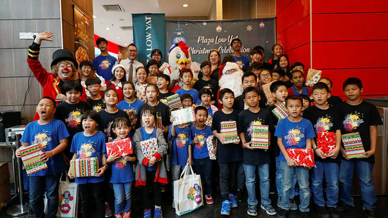 Low Yat treats children to finger-lickin' good time
