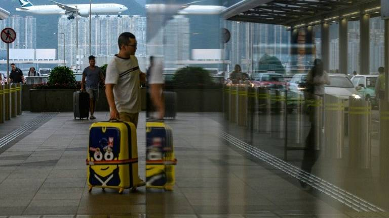 China slams HK airport protesters, US 'deeply concerned'