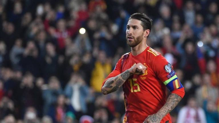 Centre-back Ramos has scored 16 goals for club and country this term. — AFP