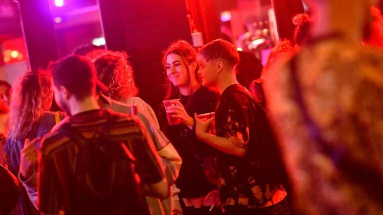 Beer flows, masks come off as England reopens pubs