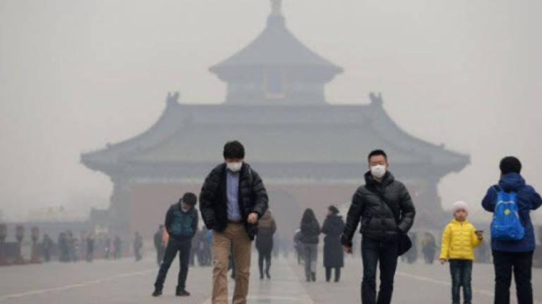 Top China weather expert warns on climate change