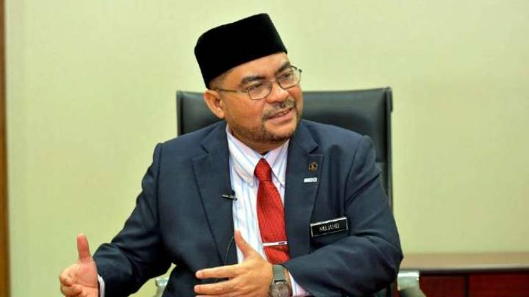 What is G25's motive in questioning Jakim's establishment: Mujahid