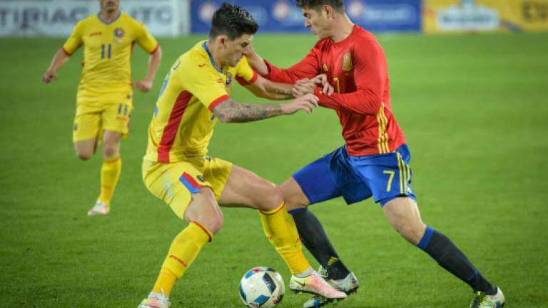 370c2b82984 Spain held in Romania on record night for Casillas