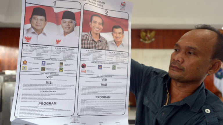 In Indonesia vote, ballots travel on horseback and by boat