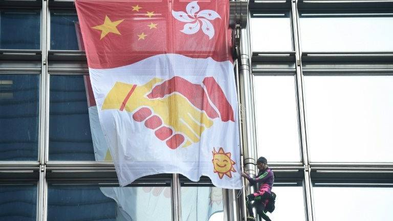 'French Spiderman' scales Hong Kong skyscraper with 'peace banner'