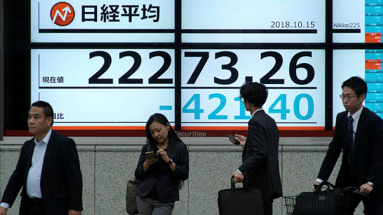 Tokyo shares open lower after Wall Street drops
