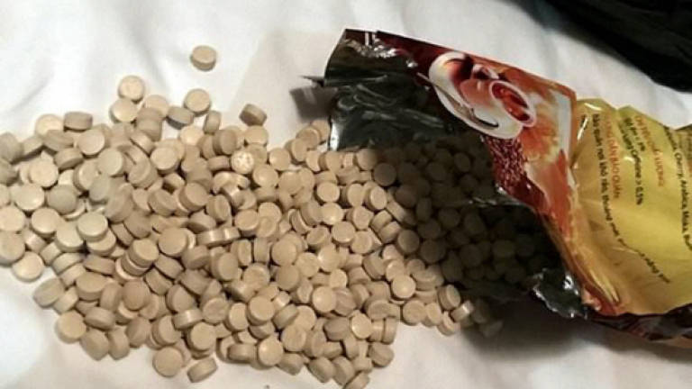 Vietnam cops bust gang using mobile labs to make ecstasy
