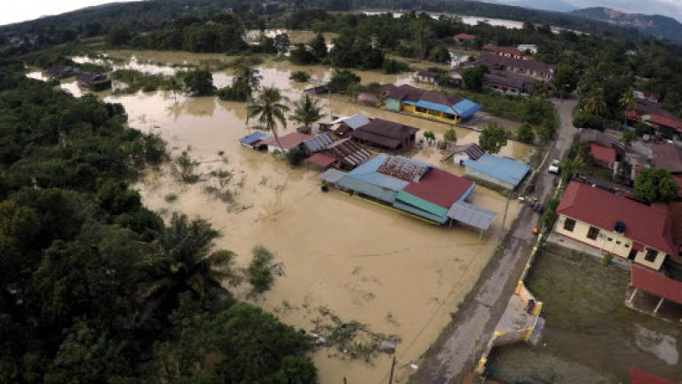 Flash floods hit Kota Kinabalu, scores of cars submerged